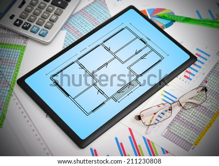 touch pad with blueprint apartament on screen - stock photo