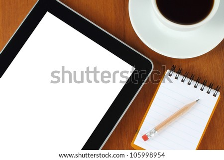 Touch screen device, notepad, pencil and cup of coffee on wooden background - stock photo