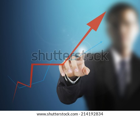 Touch Screen financial symbols coming from hand - stock photo