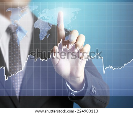 Touch Screen financial symbols coming from hand