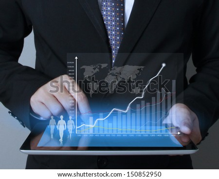touch screen graph on tablet in hands businessmen  - stock photo
