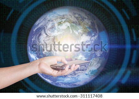Touch screen mobile phone, Elements of this image furnished by NASA - stock photo