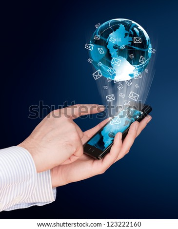 Touch screen mobile phone send mail world - stock photo