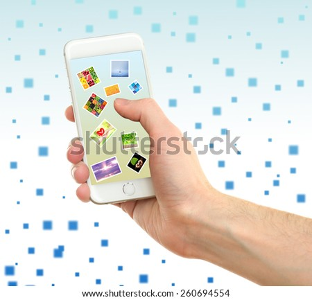 Touch screen mobile phone with beautiful images on light abstract background - stock photo