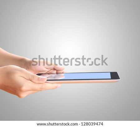 touch screen tablet and shows tablet in hand - stock photo