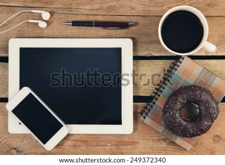 Touch screen tablet computer and telephone - stock photo