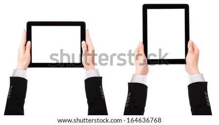 Touch screen tablet computer with blank screen and Businessman hand isolated