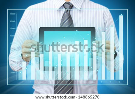 Touch screen tablet with growth chart in male hand - stock photo