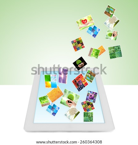 Touch screen tablet with streaming images on light background - stock photo