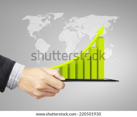 touch tablet in hand concept, with graph - stock photo