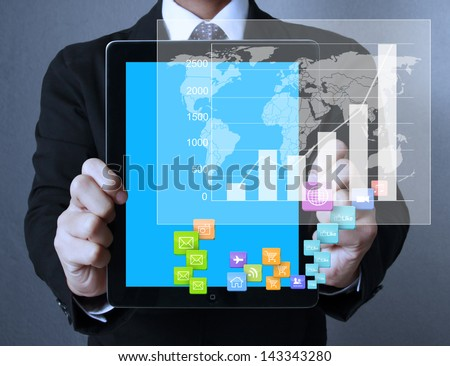 touch- tablet in hands Business man