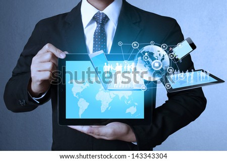 touch- tablet in hands Business man - stock photo