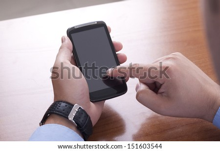 touch the Screen on the Smart Phone - stock photo