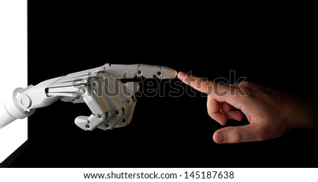 Touch to the Future Hands of robot and human isolated on black. - stock photo