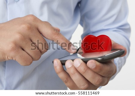Touching smart phone gift heart valentines stock photo 558111469 touching a smart phone and gift heart for valentines day negle Gallery