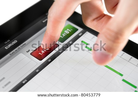 Touching sell button on stock market EUR/USD pair on a touch screen device. - stock photo