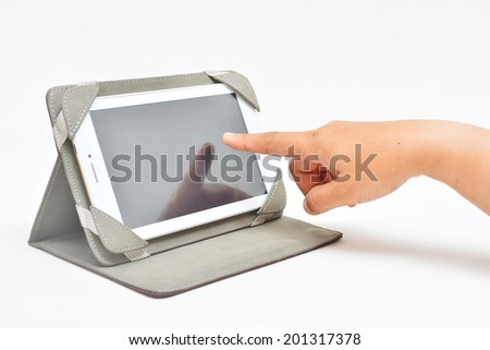 Touching tablet phone with index finger.