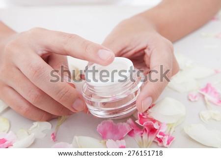touching the cream - stock photo