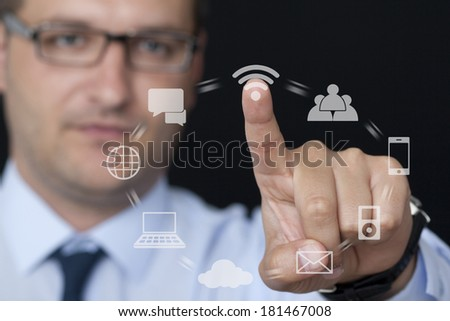 Touching the Interface Icons on the Glass - stock photo