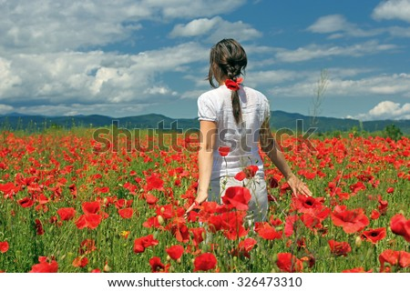 Touching the poppies - stock photo