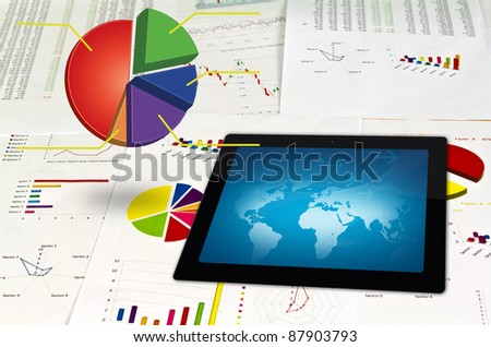 Touchpad  on financial Graphs - stock photo