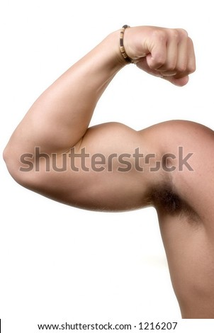 tough guy flexing bicep in studio
