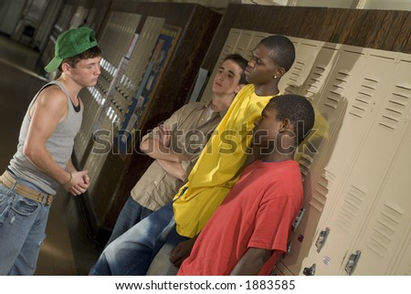 Tough guys at school hanging around the locker.  Great for peer-pressure communication.  The BAD crowd. - stock photo