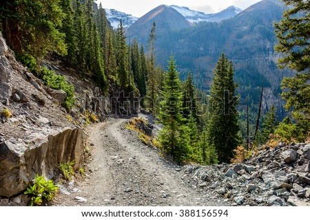 Tough High Mountain Road - Autumn day on a scenic but rough 4X4 trail, Black Bear Pass, located between top of Red Mountain Pass on US Highway 550 and Telluride in San Juan Mountains of Colorado, USA. - stock photo
