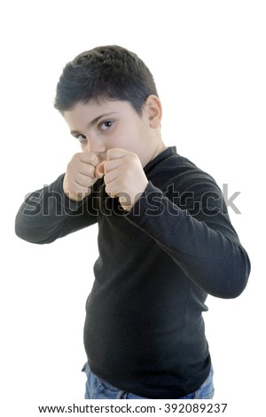 Tough little boy is bullying others and calling for a fist fight on isolated white background.