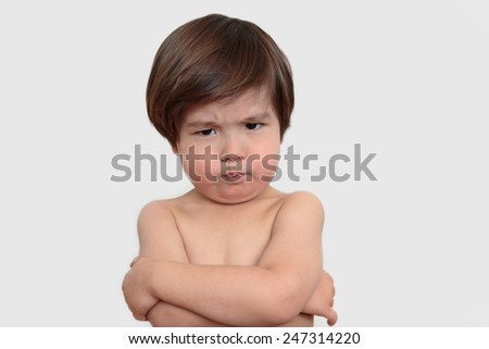 Tough toddler boy with pout expression on a neutral background - stock photo