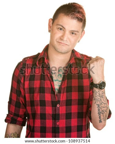Tough young man in flannel shirt with clenched fist - stock photo