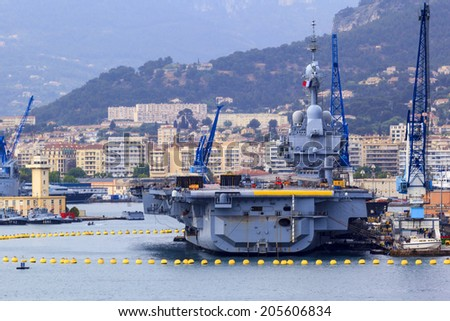 TOULON MAY -19: Rainy day in the  France Navy base at  the harbor of Toulon where the aircraft carrier Charles de Gaulle docked . 2014 France. - stock photo
