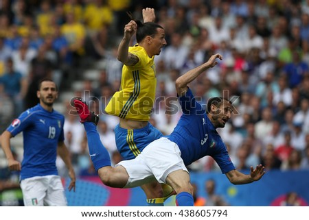 TOULOSE- FRANCE,  JUNE 2016 : Ibrahimovic, Chiellini  in action during football match  of Euro 2016  in France between ITALY VS SWEDEN at the Stade Municipal on June 17, 2016 in Toulose