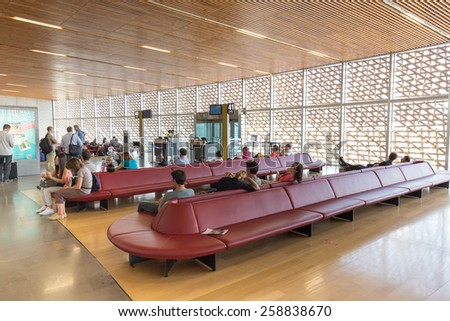 TOULOUSE, FRANCE - JULY 27, 2014: Passengers waiting in the gate at Toulouse-Blagnac airport in Toulouse, France. In 2012, the Toulouse airport served 7,559,350 passengers. - stock photo