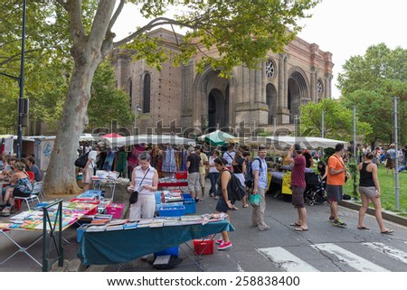 TOULOUSE, FRANCE - JULY 27, 2014: People visiting the March Saint Aubin, the Saint Aubin Market, in Toulouse. Marche Saint Aubin is only held on Sundays. - stock photo