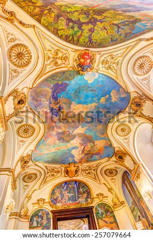 TOULOUSE, FRANCE - JULY 21, 2014: The staircase in the Capitole de Toulouse contains artworks of Jean-Paul Laurens. The artworks are called Triomphe de Clemence Isaure and Jeux floraux de Toulouse. - stock photo