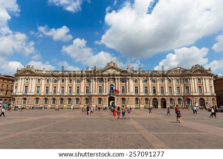 TOULOUSE, FRANCE - JULY 21, 2014: Tourists and locals pay a visit to the Capitole de Toulouse. The Capitole the Toulouse was built in 1190.