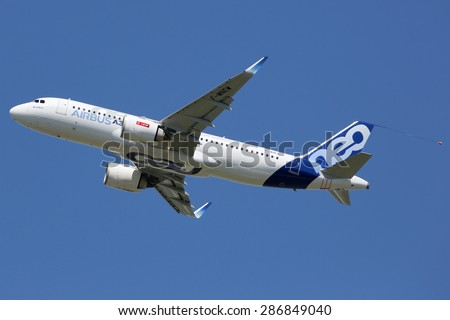 TOULOUSE, FRANCE - MAY 27:  An Airbus A320neo taking off on May 27, 2015 in Toulouse. The Airbus A320neo is the new short- to medium-range jet developed by the European aircraft manufacturer Airbus. - stock photo