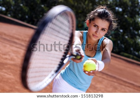 Toung pretty girl playing tennis at the beautiful weather - stock photo