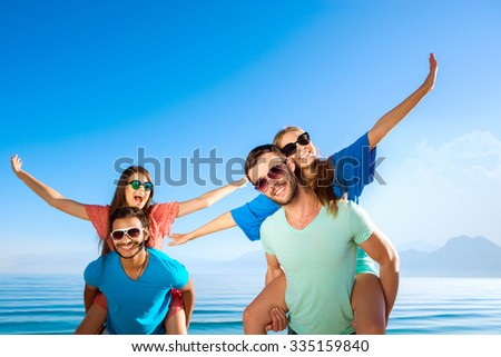 Tour by island. Tour operator. Ticket to the rest. Happy guys and girls at resort. Cheerful young people relaxing on the Mediterranean. - stock photo
