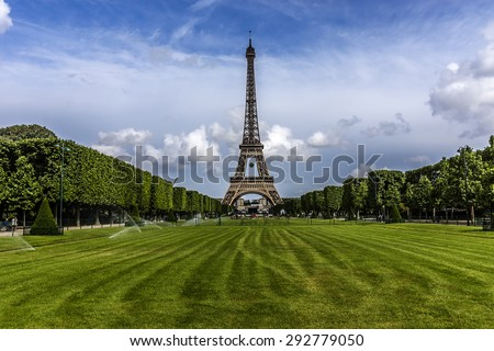 Tour Eiffel (Eiffel Tower) located on Champ de Mars in Paris, named after engineer Gustave Eiffel. Eiffel Tower is tallest structure in Paris and most visited monument in the world. France - stock photo