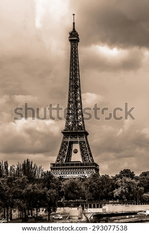 Tour Eiffel (Eiffel Tower) located on Champ de Mars in Paris, named after engineer Gustave Eiffel. Eiffel Tower is tallest structure in Paris and most visited monument in the world. France. Vintage. - stock photo