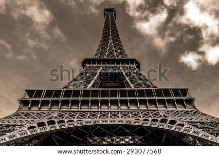 Tour Eiffel (Eiffel Tower) located on Champ de Mars in Paris, named after engineer Gustave Eiffel. Eiffel Tower is tallest structure in Paris and most visited monument in the world. France. Vintage.