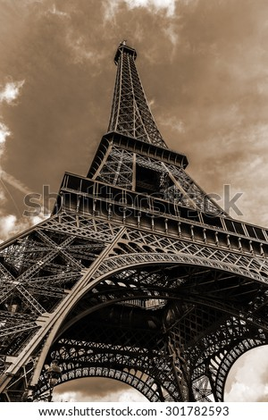 Tour Eiffel (Eiffel Tower) located on Champ de Mars in Paris, named after engineer Gustave Eiffel. Eiffel Tower is tallest structure in Paris and most visited monument in the world. France. Sepia.