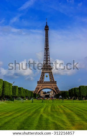 Tour Eiffel (Eiffel Tower) located on Champ de Mars in Paris, named after engineer Gustave Eiffel. Eiffel Tower is tallest structure in Paris and most visited monument in the world. France.