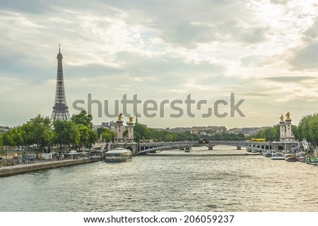 Tour Eiffel (Eiffel Tower), river Seine at sunset. Eiffel Tower, named after engineer Gustave Eiffel, is tallest structure in Paris and most visited monument in the world. Champ de Mars, Paris France.