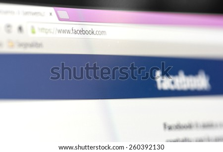 Tourin, Italy - March 14, 2015: Image of Facebook webpage on laptop. As of today, Facebook is the largest social media network on the web, March 14, 2015 in Tourin, Italy - stock photo
