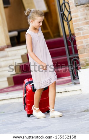 Touring Venice - girl on the way to the hotel - stock photo