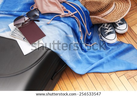 tourism background. Suitcase with things for the trip, money, tickets, passport