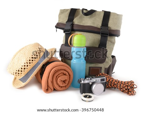 Tourism concept. Backpack, rug and camera isolated on white background - stock photo
